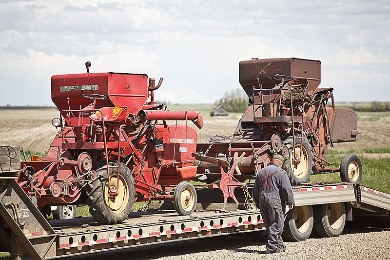 This image has an empty alt attribute; its file name is 800px-Two_Massey-Harris_combines.jpg